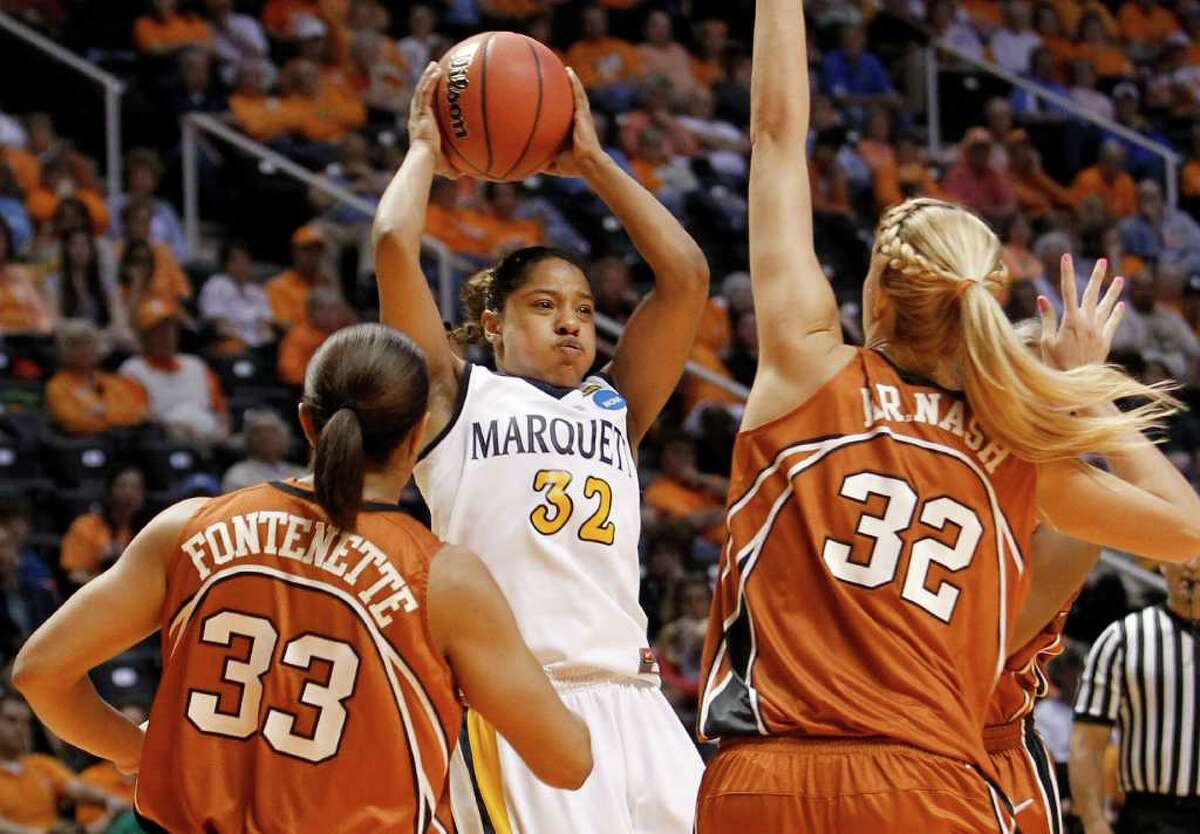 Marquette guard Angel Robinson (32) passes away from Texas defenders Ashleigh Fontenette (33) and Kristen Nash (32) during the first half of a first round game in the NCAA college basketball tournament on Saturday, March 19, 2011, in Knoxville, Tenn. Robinson led Marquette with 19 points as they beat Texas 68-65.