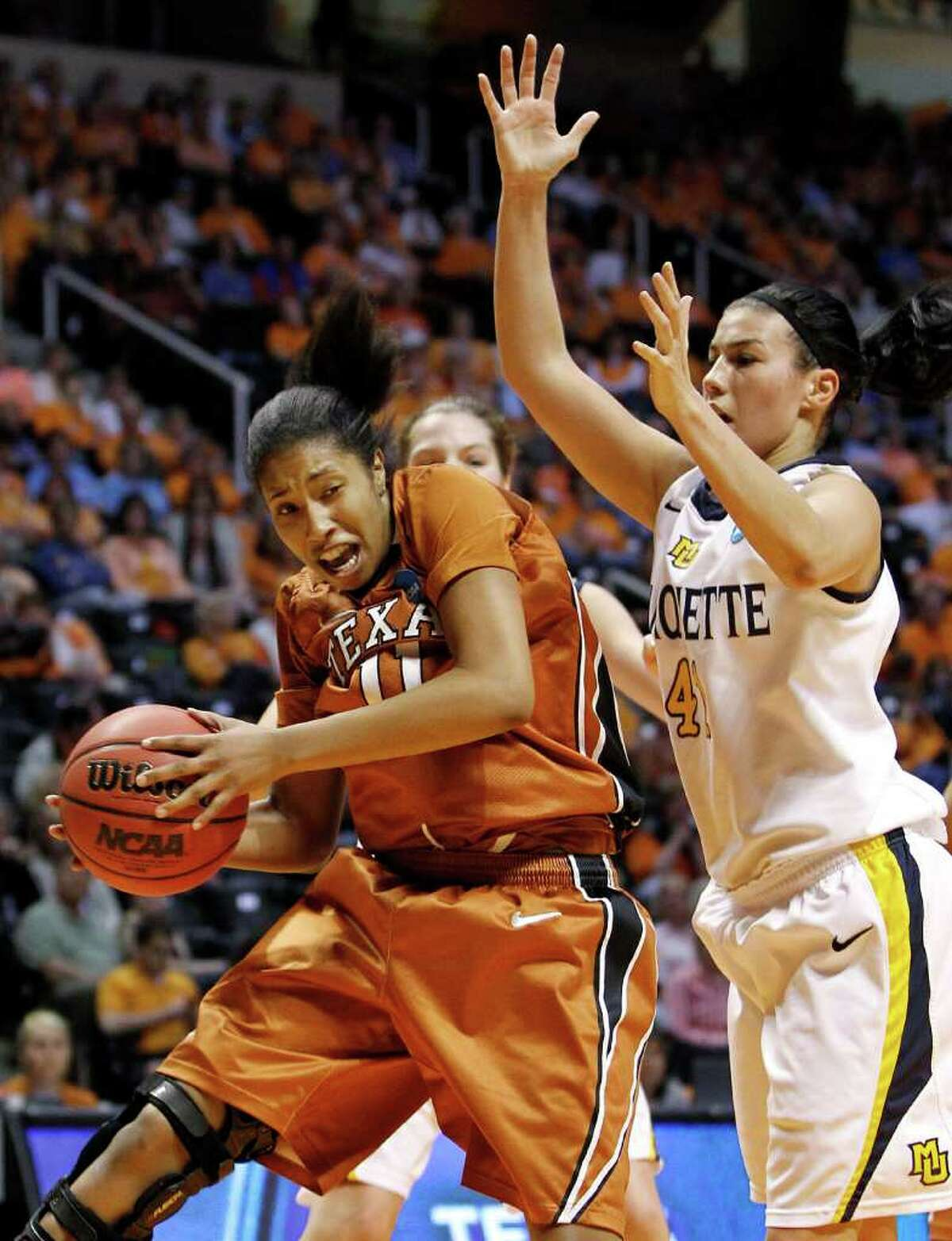 Texas guard Chelsea Bass (11) takes a rebound away from Marquette forward Paige Fiedorowicz (41) during the first half of a first round game in the NCAA college basketball tournament on Saturday, March 19, 2011, in Knoxville, Tenn.