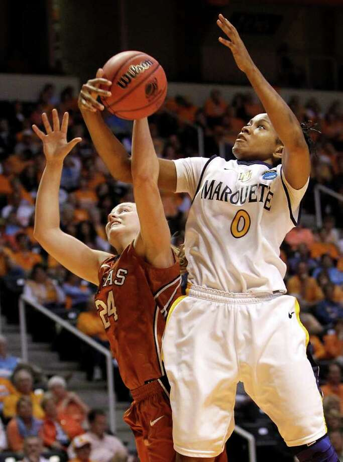 Marquette forward Jasmine Collins (0) takes a rebound away from Texas guard Chassidy Fussell (24) during the first half of a first round game in the NCAA women's college basketball tournament on Saturday, March 19, 2011, in Knoxville, Tenn. Photo: AP Photo/Mark Humphrey