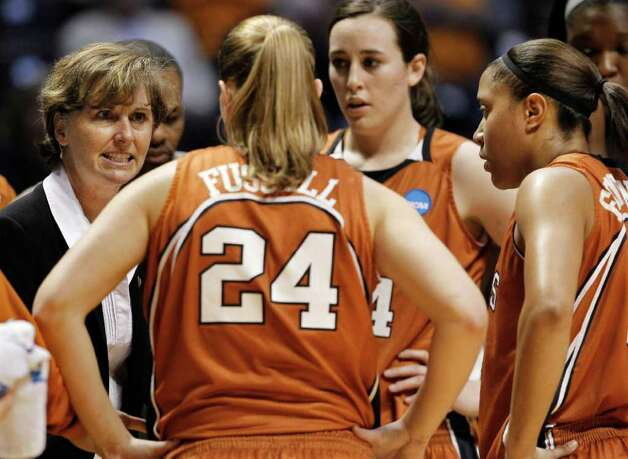 Texas head coach Gail Goestenkors, left, talks with her team, including Chassidy Fussell (24), Anne Marie Hartung, third from left, and Ashleigh Fontenette, right, during the second half of a first round game against Marquette in the NCAA college basketball tournament on Saturday, March 19, 2011, in Knoxville, Tenn. Marquette won 68-65. Photo: AP