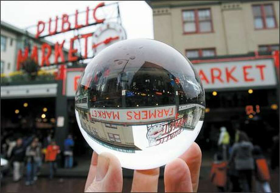 You can buy almost anything, including carrots, kites and crystal balls, at Pike Place Market in Seattle. The Market celebrates its centennial starting today. Photo: Mike Urban/Seattle Post-Intelligencer