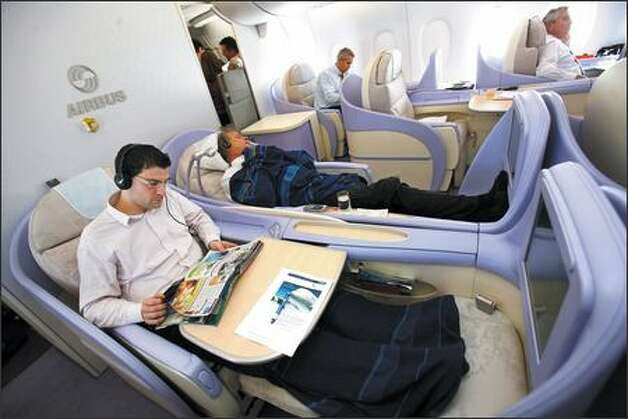 Passengers relax during travel from Frankfurt to New York in the Airbus A380, Monday. Airbus SAS's 555-seat, double-decker A380, the largest passenger plane ever built, made its U.S. debut today, with planes landing within 18 minutes of each other in New York and Los Angeles. Photo: / Bloomberg News
