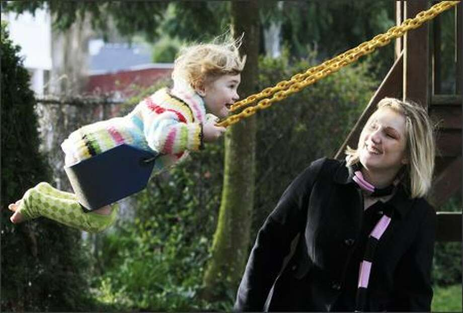 Nicole Donnelly watches daughter Sara swing in their West Seattle yard, wearing her stylish Babylegs. Donnelly's business is growing as fast as her 2-year-old. Photo: Dan DeLong/Seattle Post-Intelligencer