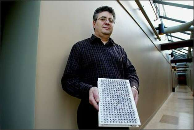 "Michael Ikonomou, a research scientist with the Canadian government's Department of Fisheries and Oceans' Institute of Ocean Sciences in Sidney, B.C., has developed techniques for fingerprinting contaminants that are tricky to find, including PBDEs. Because scientists began looking for PBDEs in the environment only in recent years, he's applied the technique to samples that have been frozen for decades, including the samples he is holding here. Ikonomou found that PBDE levels in seal blubber have been doubling every few years since the early 1980s. Asked where PBDEs are being found, Ikonomou replies: ""Everywhere. We find them in the dust on top of mountains."" Photo: Paul Joseph Brown/Seattle Post-Intelligencer"