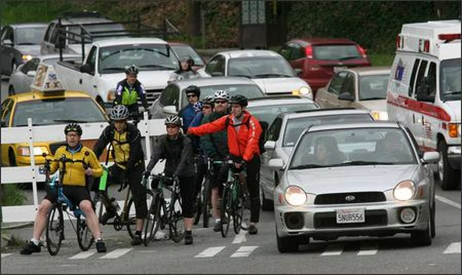Bicycle commuters wait for the light to change Monday at the intersections of Dexter Avenue North, Westlake Avenue North and Nickerson Street. Photo: Mike Urban/Seattle Post-Intelligencer