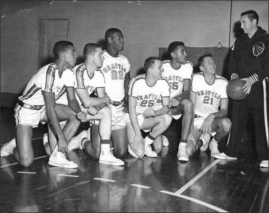 Coach John Castellani, far right, with SU players, from left, Lloyd Murphy, Jim Harney, Elgin Baylor, Bob Miller, Thornton Humphries and Dick Stricklin in 1957. Photo: /Seattle Post-Intelligencer