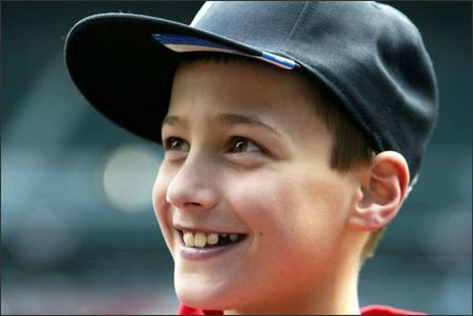 Ryan Schroeder, 10, of Maple Valley, was chosen by the Make-A-Wish Foundation to run the bases before today's game at Safeco Field. Ryan has a complex congenital heart disease. Photo: Meryl Schenker/Seattle Post-Intelligencer