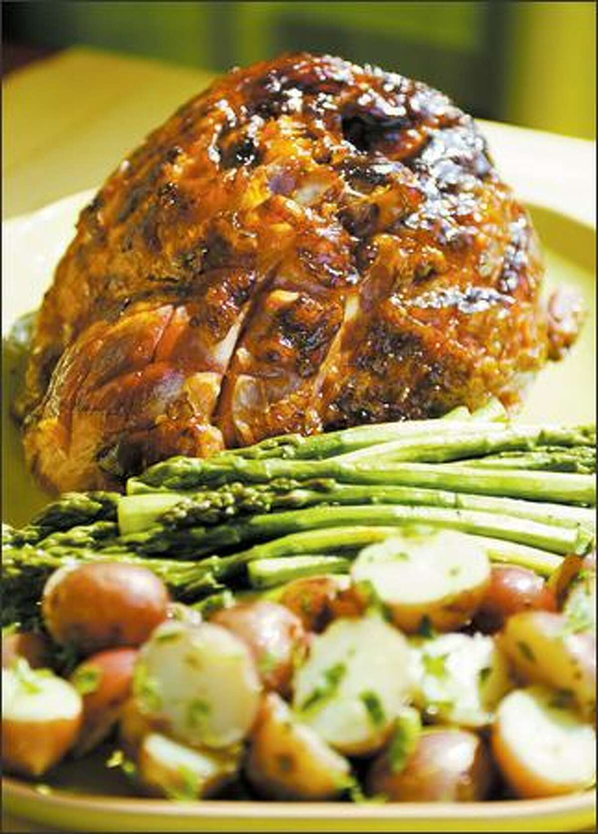 Kurobuta pork from Snake River Farms goes well with steamed asparagus and potatoes. Our tasters found it tender.
