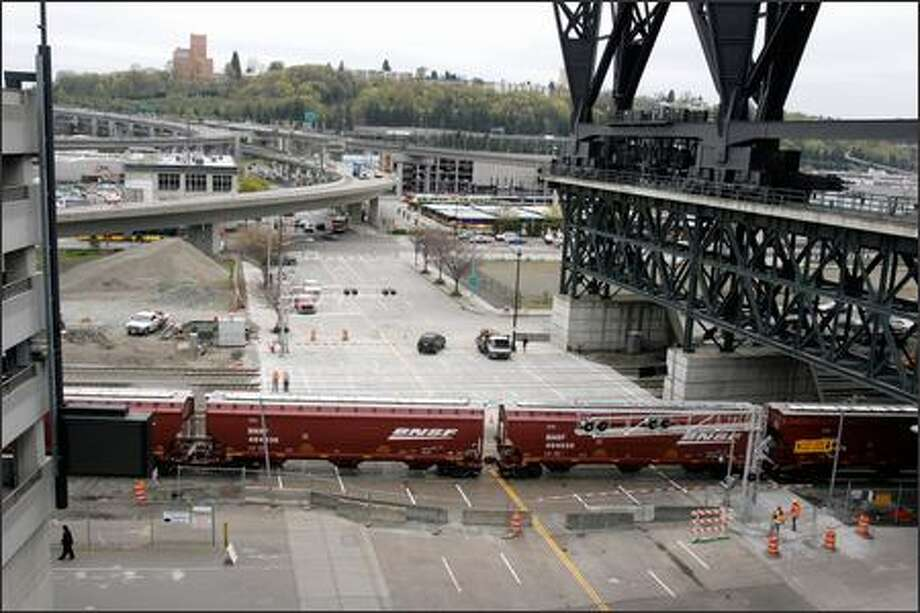 On Royal Brougham Way northeast of Safeco Field, the railroad crossing gates now have arms that lower to block pedestrians when trains are coming. Photo: Meryl Schenker/Seattle Post-Intelligencer