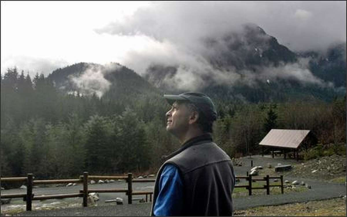 Mark Boyar looks at the peaks surrounding the Middle Fork Snoqualmie campground, a facility he was instrumental in getting built. The campground, which opened in May, was the first in the Mount Baker-Snoqualmie National Forest since the 1970s.