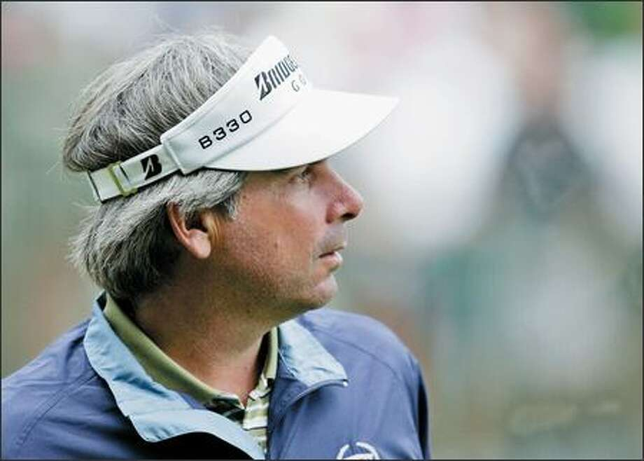 Fred Couples stands on the practice green before practice for the 2007 Masters golf tournament at the Augusta National Golf Club in Augusta, Ga., Wednesday. Calf and back injuries have limited Couples to only two rounds this season. First round play begins on Thursday. Photo: / Associated Press
