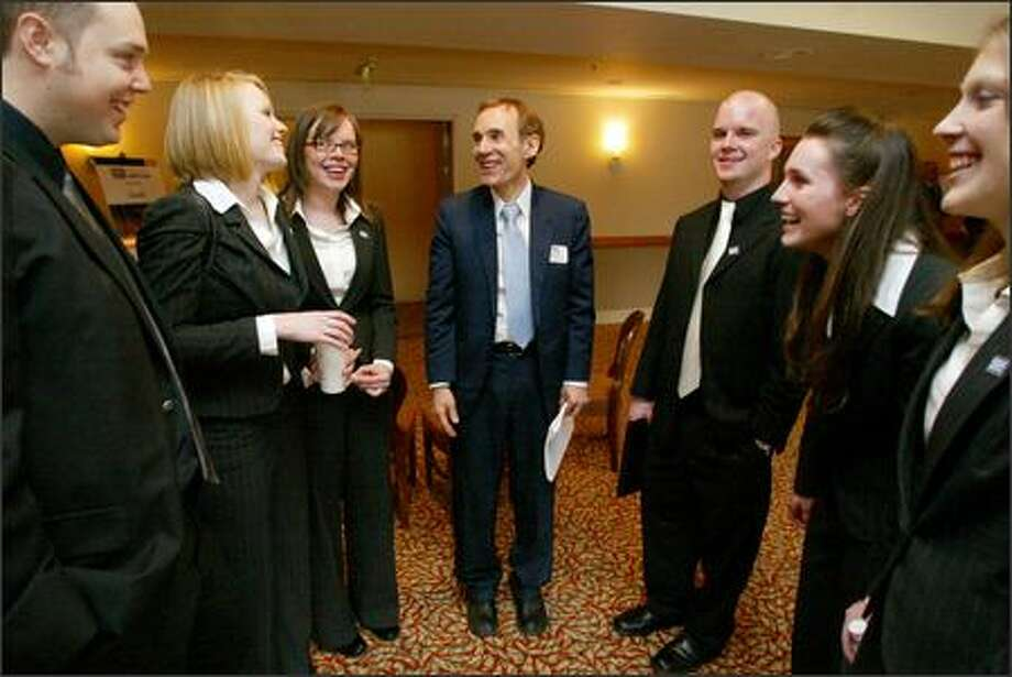 Students from Northwest University's SIFE (Students In Free Enterprise) team discuss their performance with Tom Sill, center, associate professor in the Kirkland university's School of Business and the faculty adviser for the team competition. Photo: Paul Joseph Brown/Seattle Post-Intelligencer