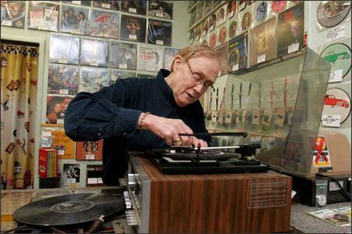 Jim Goff, owner of JNS Phonograph Needles, assesses the problem with a turntable brought in by a customer from Marysville.