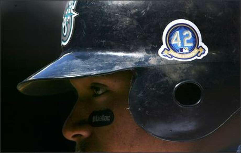 Jose Lopez warms up while wearing a batting helmet bearing sticker honoring Jackie Robinson. Major League Baseball celebrated the 60th Anniversary of Robinson's breaking the sport's color barrier. (Andy Rogers/Seattle Post-Intelligencer) Photo: Andy Rogers/Seattle Post-Intelligencer