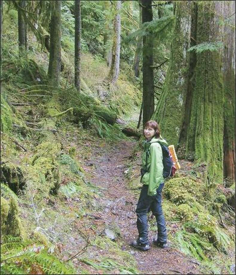 Barbara Eller of Seattle pauses along the Boulder River Trail, a lowland hike near Darrington. Photo: Karen Sykes/Special To The Post-Intelligencer