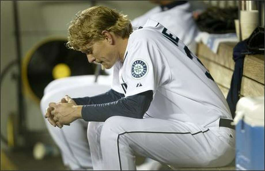 Seattle Mariners pitcher Jeff Weaver sits on the bench after a disastrous 5th inning against the Minnesota Twins that included a grand slam on Tuesday at Safeco Field during the fifth inning in Seattle. Photo: Joshua Trujillo/Seattle Post-Intelligencer