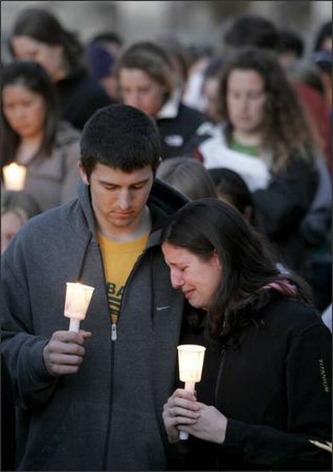 University of Washington students Mark Gegax, 20, and Marina Pita, 19, join about 200 others in a candlelight vigil on campus in memory of those who were killed at Virginia Tech earlier this week. Photo: Meryl Schenker/Seattle Post-Intelligencer