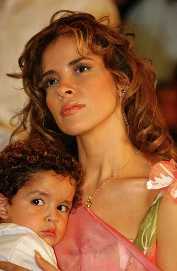 Pop singer star Gloria Trevi embraces her son Angel Gabriel upon her arrival to the metropolitan Cathedral during a mass, Thursday Sept. 23, 2004, in Monterrey, Mexico, to give thanks to Virgen of Guadalupe after her liberation from prision. Trevi was acquitted of rape, kidnapping and corruption of minors charges late Tuesday and ordered released from prison. Photo: JOSE LUIS MAGANA, AP / AP