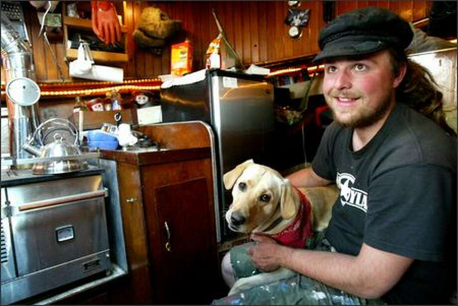 Sam Waikel, from Auburn, Calif., and his dog Lucy live aboard his salmon troller months at a time before and after the summer fishing season while he works on it at Fishermen's Terminal. Photo: Karen Ducey/Seattle Post-Intelligencer