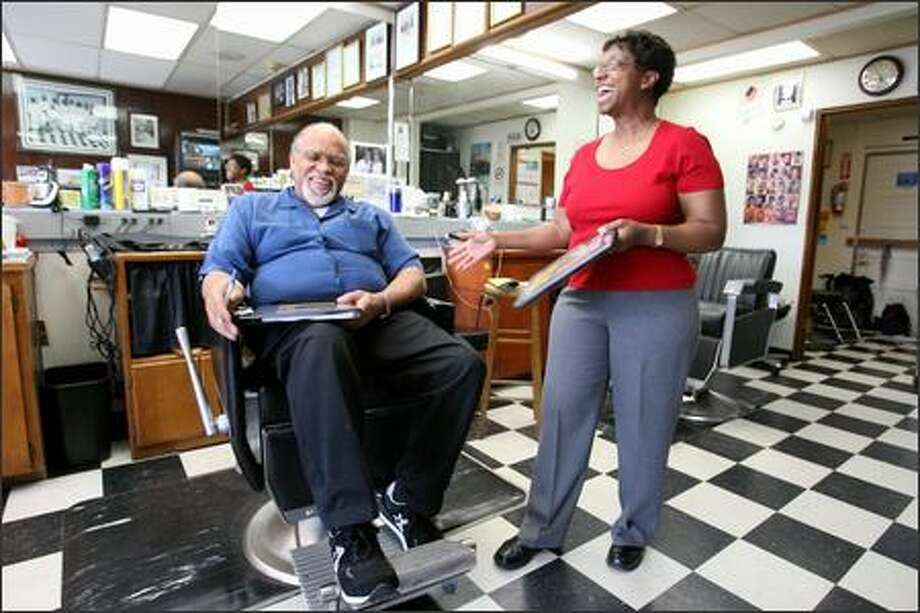 Nurse Ethlyn Gibson trains Willie Hodge, owner of Hodges Hair Quarters, in the Power to Live Smart program to train barbers and stylists to talk about heart health. Photo: Scott Eklund/Seattle Post-Intelligencer