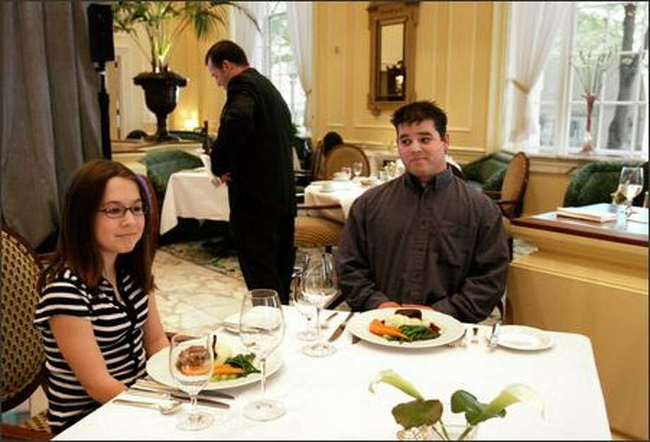 Kelly Grady, 13, left, and Sean McNally, 27, take part in an etiquette class on fine dining at the Fairmont Olympic Hotel. Photo: Meryl Schenker/Seattle Post-Intelligencer