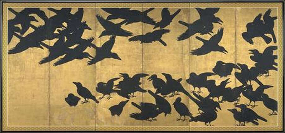 "One of the two six-panel, 17th century screens that make up ""Crows,"" one of SAM's most popular works. The screens show black inked birds in flight amid the gold. Photo: Paul Joseph Brown/Seattle Post-Intelligencer"