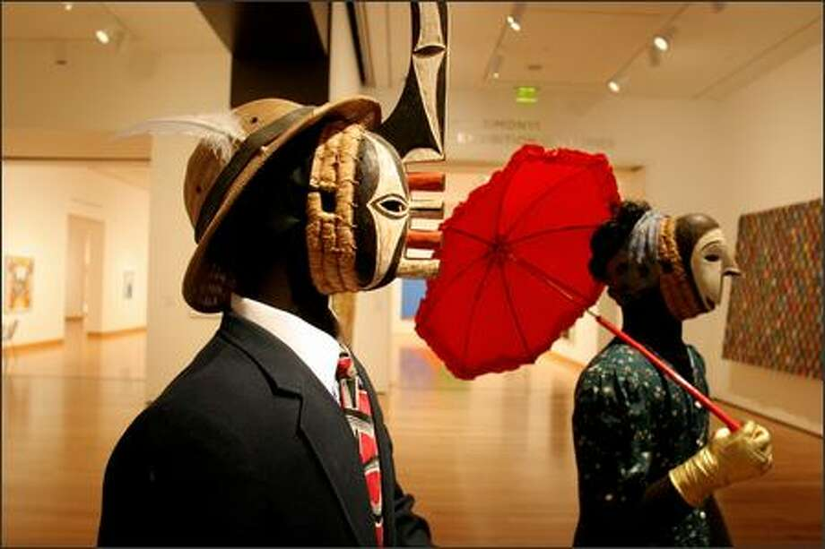 The African galleries include these masked figures from Nigeria, dressed for a village masquerade. Photo: Paul Joseph Brown/Seattle Post-Intelligencer