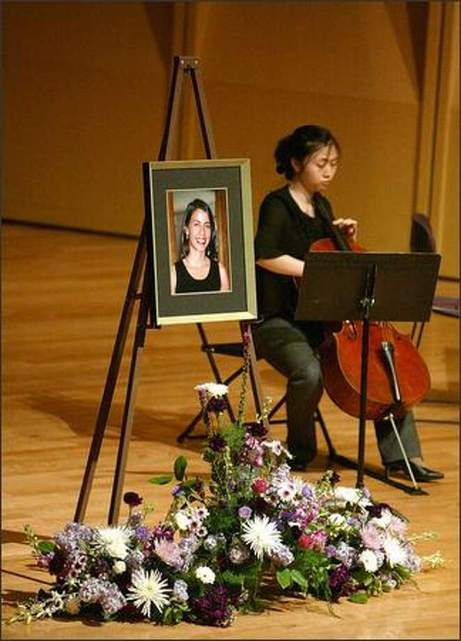 Hae-Yoon Shina plays the cello Monday during a memorial service for Rebecca Griego at the University of Washington. Griego, 26, was shot April 2 on campus by her ex-boyfriend. Photo: Gilbert W. Arias/Seattle Post-Intelligencer