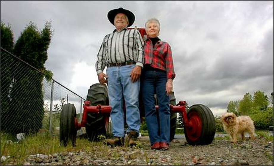 Don and Toni Ihry stand in front of one of the many tractors they own at their home in Kent on Tuesday. Photo: Scott Eklund/Seattle Post-Intelligencer