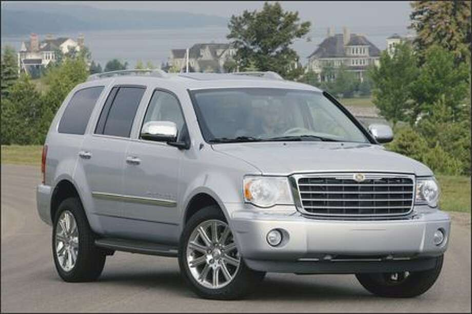 The 2007 Chrysler Aspen is a full-size sport utility with room for up to eight passengers. Standard amenities include front and rear heat and AC, power mirrors/windows/door locks with remote, a rear parking-assist system and a power rear liftgate. Photo: Chrysler Group