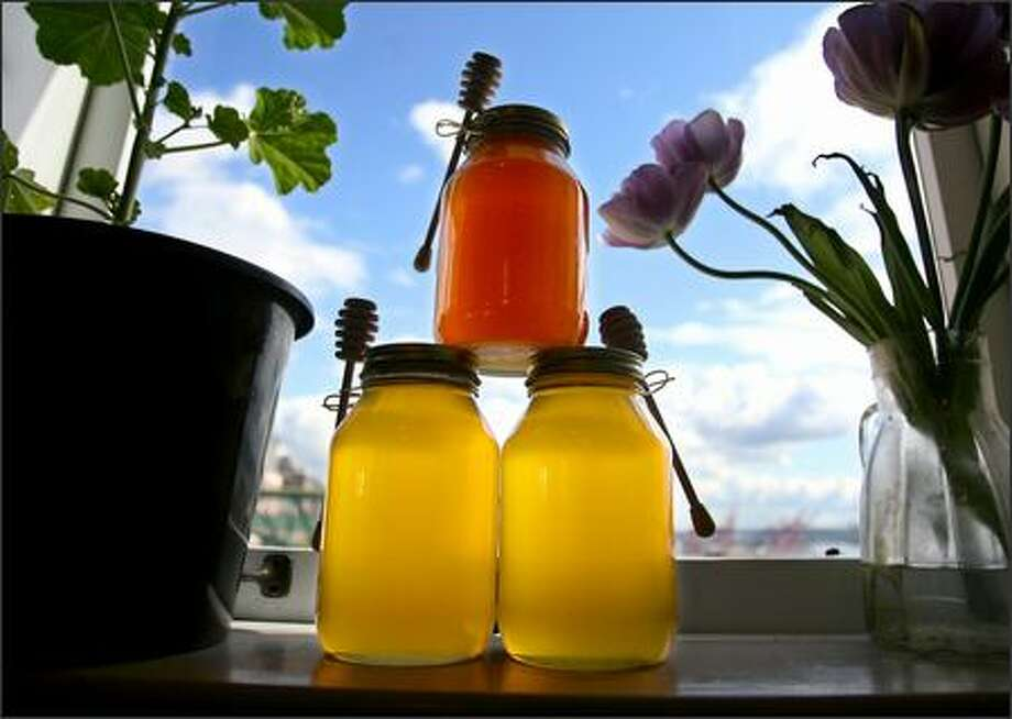 Moon Valley Organics sells honey at Pike Place Market. Owner Kim Denend said bees have been having a difficult time for a decade. Photo: Scott Eklund/P-I Photo Illustration