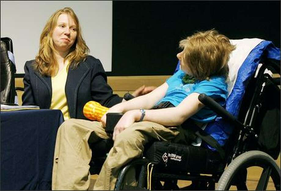 Gail Lainhart-Rivas of Spokane talks about the similarities between her 17-year-old daughter, Sarah, with 9-year-old Ashley, who endured a growth-stunting surgery that has since been found in violation of state law. Children's Hospital said it believed it was complying with the law when it approved the surgery. Photo: Gilbert W. Arias/Seattle Post-Intelligencer