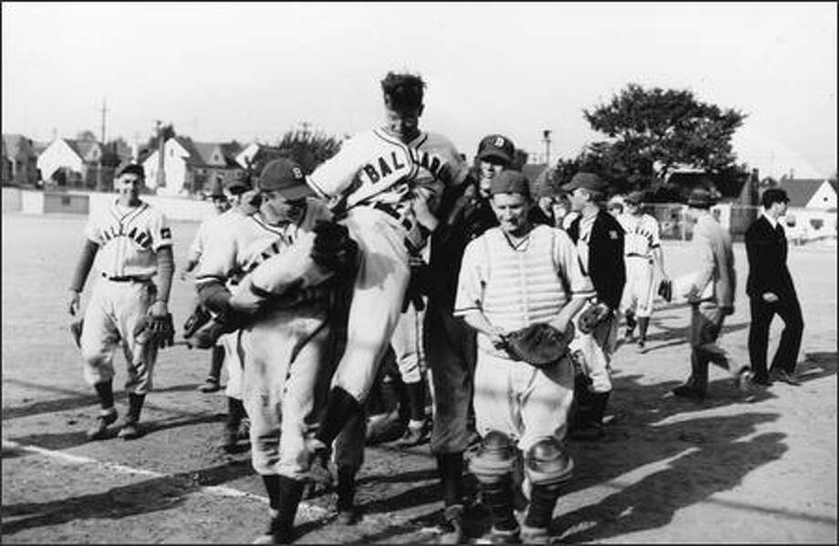 Gene Verburg is carried off the field by his Ballard teammates after throwing a no-hitter against Roosevelt on May 19, 1950. Photo: / Family Photo