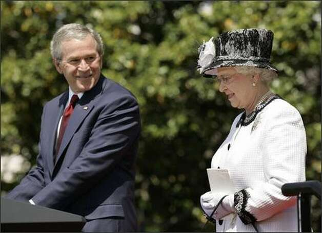 President Bush makes a small faux pas while welcoming Queen Elizabeth II to the White House on May 7. (AP Photo/Gerald Herbert) Photo: /Associated Press