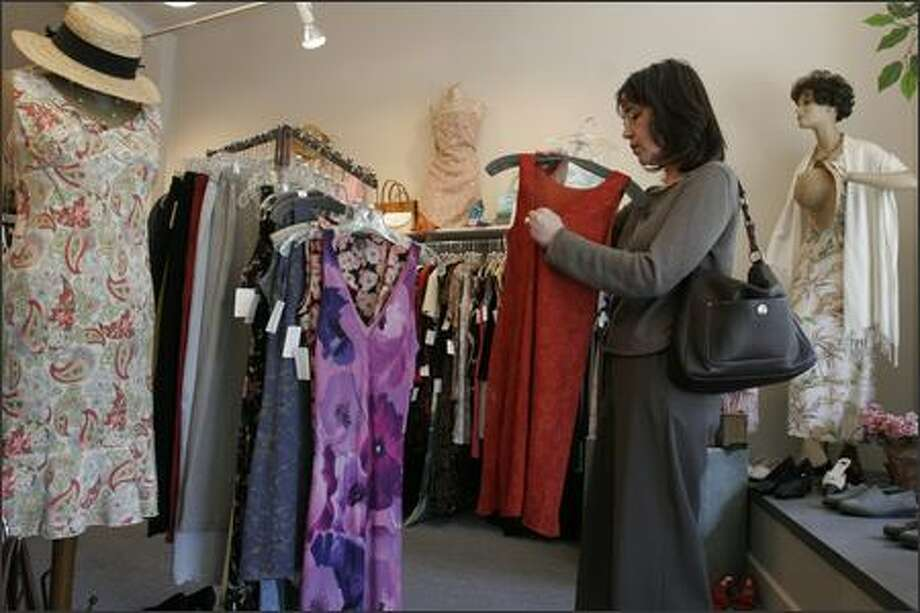 "Felipa's customer Mary Clare Thompson likes gently used clothing ""because you know how it's going to fit and ... wear because it's already"" washed. Photo: Meryl Schenker/Seattle Post-Intelligencer"