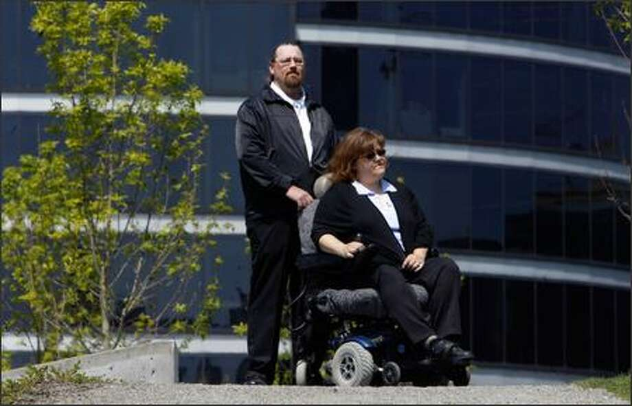 Tara Sadler, with husband Don, contends she became permanently disabled because State Farm would not immediately agree to recommended surgeries. Photo: Andy Rogers/Seattle Post-Intelligencer