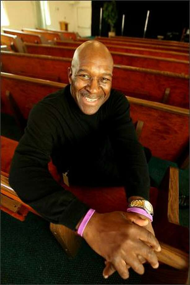 The Rev. George Frost and his Abundant Life Christian Church in South Seattle will don purple bracelets next month to discourage whining and complaining. Photo: Scott Eklund/Seattle Post-Intelligencer