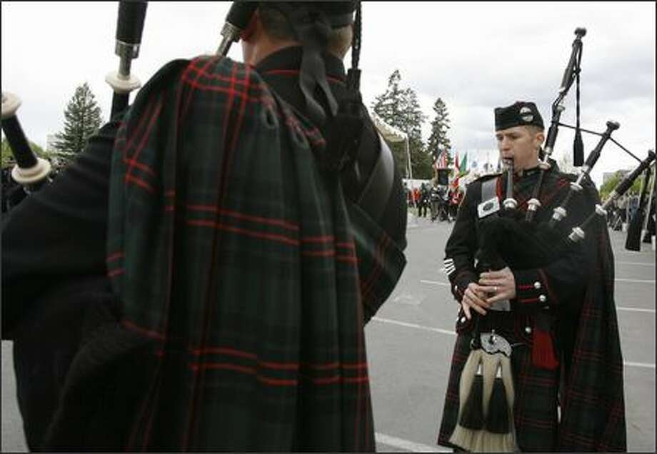 Seattle Fire Department medic Les Davis, left, and firefighter Spencer Nelson, both members of the Seattle Fire Department Pipes and Drums Band, play the bagpipes as the squad performs at the Law Enforcement Officers Memorial May 4 in Olympia. Photo: Gilbert W. Arias/Seattle Post-Intelligencer