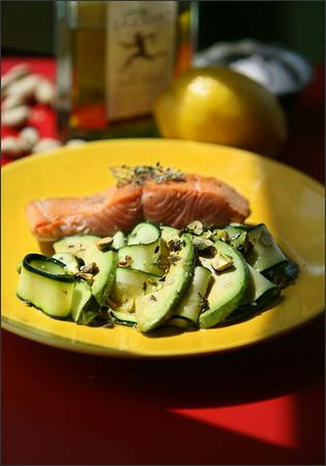 Zucchini Carpaccio With Avocado, Lemon Thyme and Pistachio Oil is served with a side of grilled salmon. Photo: SCOTT EKLUND