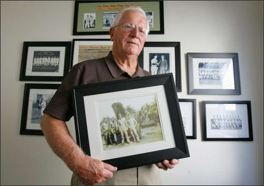 Len Tran, 82, retired from Boeing and living in Puyallup, holds a picture from his World War II days. Photo: Gilbert W. Arias/Seattle Post-Intelligencer
