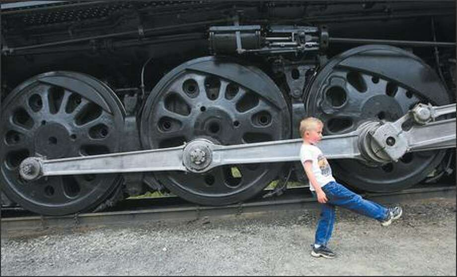 Five-year-old Stephen Breckenridge of Mount Vernon marches along as he gets a look Wednesday at Steam Locomotive No. 844, the last steam locomotive built for Union Pacific Railroad. It was delivered in 1944. It is currently on display at the rail yard in Fife, along with other steam locomotives. Photo: Scott Eklund/Seattle Post-Intelligencer
