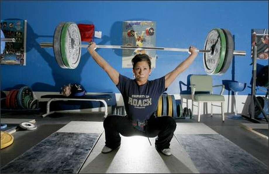 Weightlifter Melanie Roach works out in the gym at the business she owns, Roach Gymnastics. Roach, of Bonney Lake, is hoping to qualify for the Beijing Olympics. Photo: Gilbert W. Arias/Seattle Post-Intelligencer