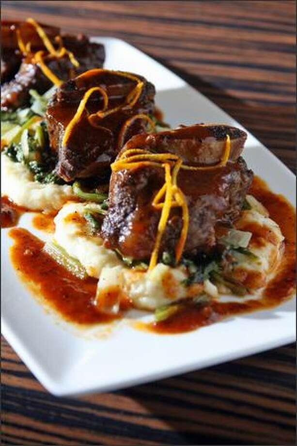 Marazul's Char Sui Short Ribs come with cassava mash, mustard greens and orange zest. Photo: Mike Urban/Seattle Post-Intelligencer