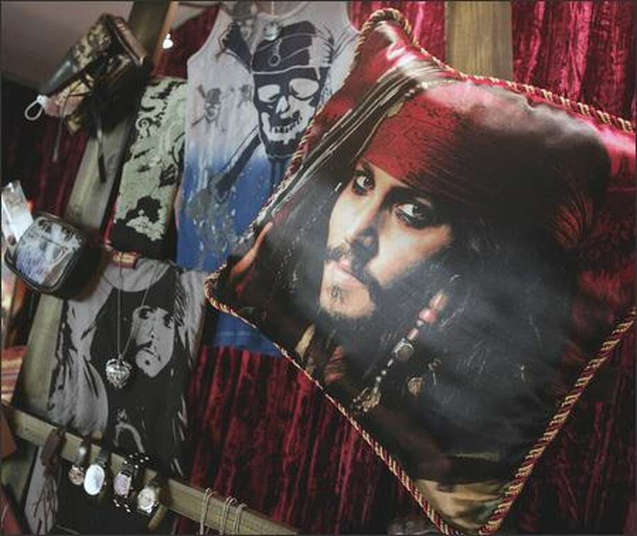 A pillow? Arrr! Actor Johnny Depp's likeness appears on a pillow, one of many pirate-themed products that are so hot right now. Photo: / Associated Press