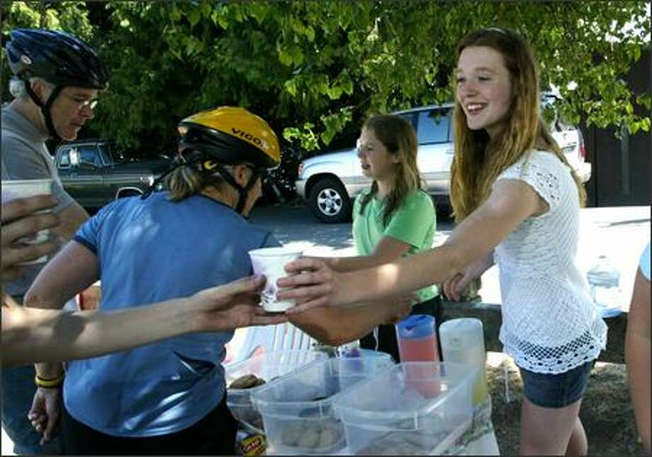 Last summer, Laura D'Asaro, then 15, and friends ran a lemonade and cookies stand on the Burke-Gilman Trail to raise funds for playground equipment at Matthews Beach Park. Photo: KAREN DUCEY/P-I