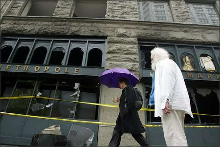 Reverend C. Lockland surveys the damage in the historic Metropole building at 423 Second Avenue in Pioneer Square. A fire early Monday morning gutted the first floor of the building, which dates to the 1890s, and was home to G.O. Guys drugstore until the 1960s. Photo: PAUL JOSEPH BROWN/P-I