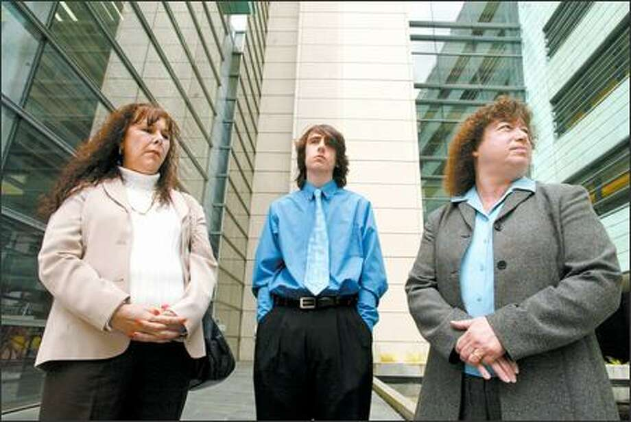 Gregory Requa, a senior at Kentridge High School, was suspended for 40 days for his alleged role in the production of a video critical of a teacher that was posted online. He, his mother, Marlene Requa, left, and their attorney, Jeannette Cohen, are asking the court to lift the suspension. Photo: Paul Joseph Brown/Seattle Post-Intelligencer