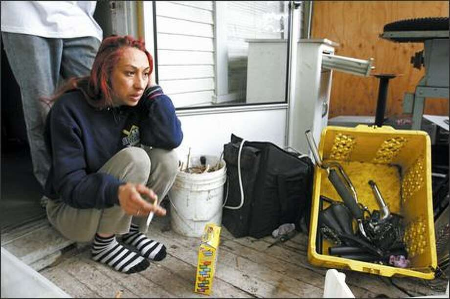 "Kara Andersen was one of several people ordered by the city Monday to vacate a rental house in the Roosevelt area. They said they didn't pay rent, but in exchange were putting in their own time and money to fix up the place. ""We were making ourselves a home here,"" she said. Photo: Meryl Schenker/Seattle Post-Intelligencer"