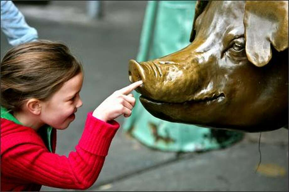 Rachel's snout has always been a magnet for children's curious fingers. The bronze pig has collected $120,000 since it was installed in 1986. Photo: Mike Urban/Seattle Post-Intelligencer