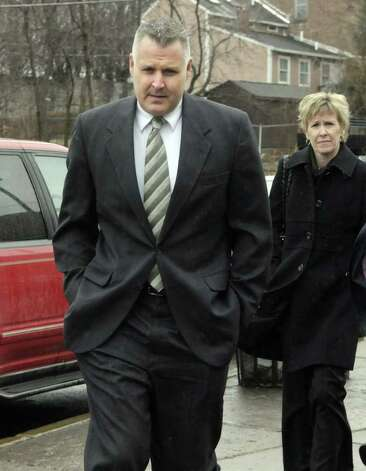 Suspended Albany detective James Miller, left,  makes his way into Albany City Court on Monday, March 21, 2011, for his arraignment on charges of driving while intoxicated.  Miller, a  longtime spokesman for the Albany Police Department, was pulled over Friday night.  (Paul Buckowski / Times Union) Photo: Paul Buckowski  / 00012473A